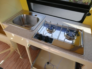 The kitchen counter with our Eno stove and sink