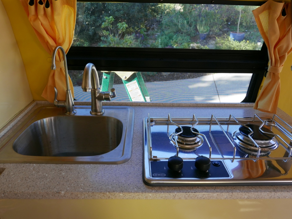 Our kitchen with a bar sink and a eno marine stove