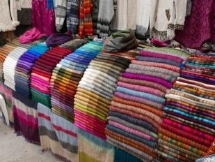 Beautiful colors of alpaca scarfs at the Otavalo Market